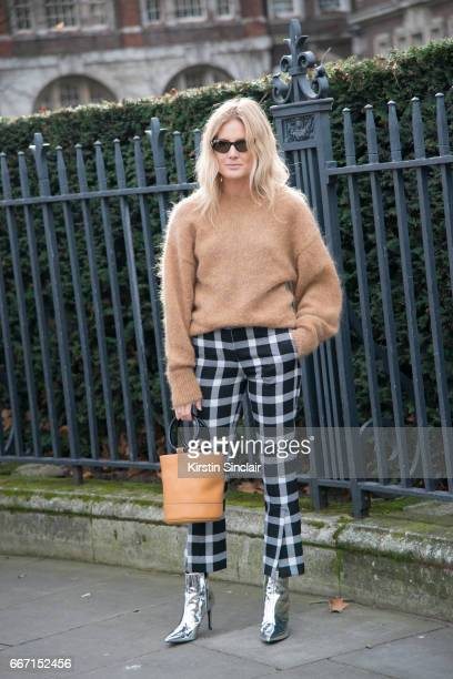 Fashion blogger Lucy Williams wears Christopher Kane trousers Other Stories sweater Topshop boots Simon Muller bag and Gucci sunglasses on day 4 of...