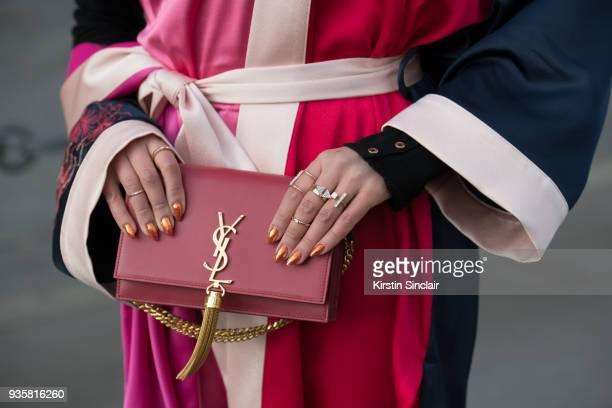 Fashion blogger macademiangirl Tamara Gonzalez Perea wears a Pinko dress and kimono YSL bag day 3 of Paris Womens Fashion Week Spring/Summer 2018 on...