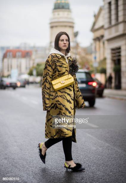 Fashion blogger Maria Barteczko wearing a tiger jacquard coat Christopher Kane Off White printed hoody Charms black skinny jeans Saint Laurent...
