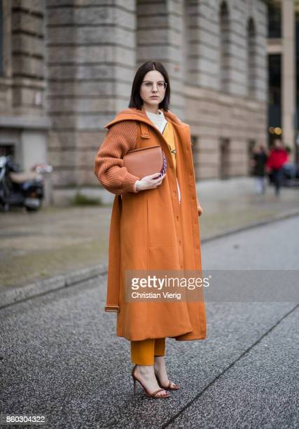 Fashion blogger Maria Barteczko wearing orange long wool coat with knitted sleeves Chloe embroidered flower sweatshirt Christopher Kane classic...