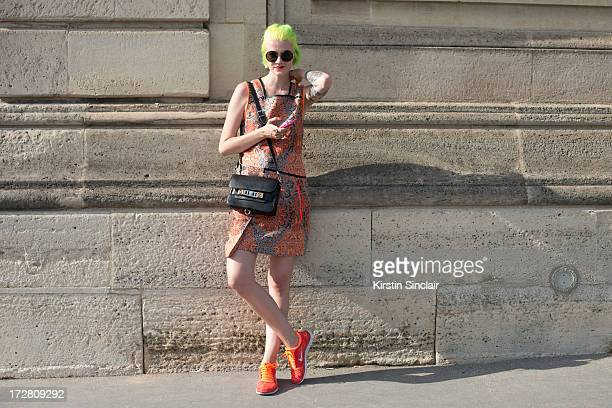 Fashion Blogger Marianna Theodorsen wears a Helmut Lang dress Proenza Schouler Bag The Row sunglasses and Nike trainers on day 1 of Paris Collections...
