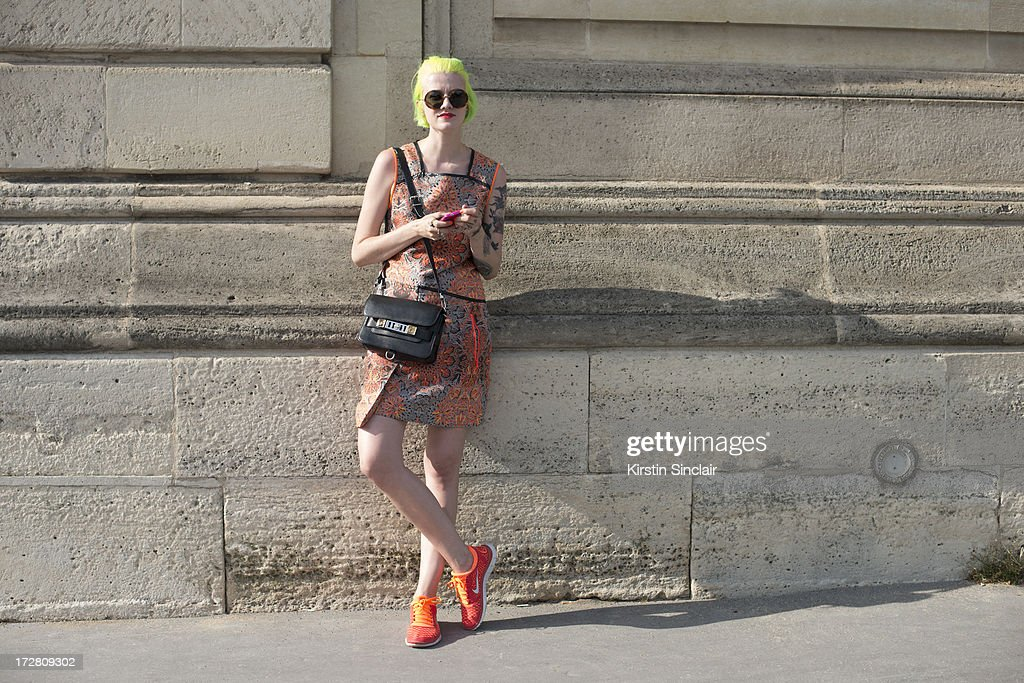Fashion Blogger Marianna Theodorsen wears a Helmut Lang dress, Proenza Schouler Bag, The Row sunglasses and Nike trainers on day 1 of Paris Collections: Womens Haute Couture on July 01, 2013 in Paris, France.