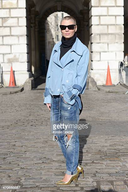 Fashion blogger Marie Ullevoldsater wears Zara shoes and jeans Acne jacket Saint Laurent bag Tom Wood jewellery Celine sunglasses and H and M sweater...