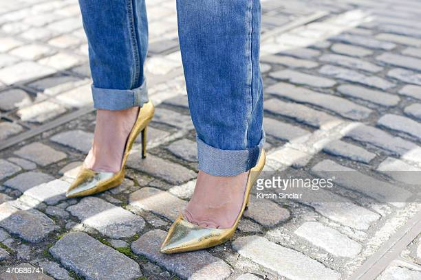Fashion blogger Marie Ullevoldsater wears Zara shoes and jeans on day 3 of London Collections Women on February 16 2014 in London England