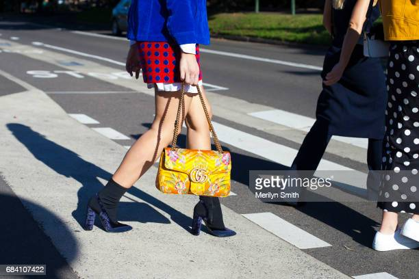 Fashion Blogger Marissa Karagiorgos wearing a Marc Jacobs jacket Miu Miu skirt Camilla and Marc boots and Gucci bag during MercedesBenz Fashion Week...