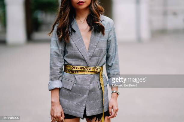 Fashion blogger Maymaryb wears a gray blazer jacket an OffWhite yellow belt a watch during London Fashion Week Men's June 2018 on June 09 2018 in...
