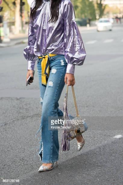 Fashion blogger Melanie Darmon wears an ASOS blouse Balenciaga jeans Jimmy Choo bag Celine sunglasses and Zara shoes day 1 of Paris Womens Fashion...