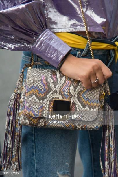 Fashion blogger Melanie Darmon wears an ASOS blouse Balenciaga jeans Jimmy Choo bag day 1 of Paris Womens Fashion Week Spring/Summer 2018 on...