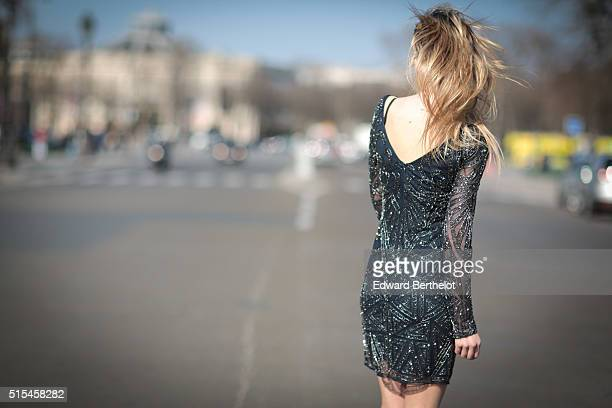 Fashion Blogger Meryl Denis is wearing a Lace and Beats dress and Zara shoes during a street style session on March 13 2016 in Paris France
