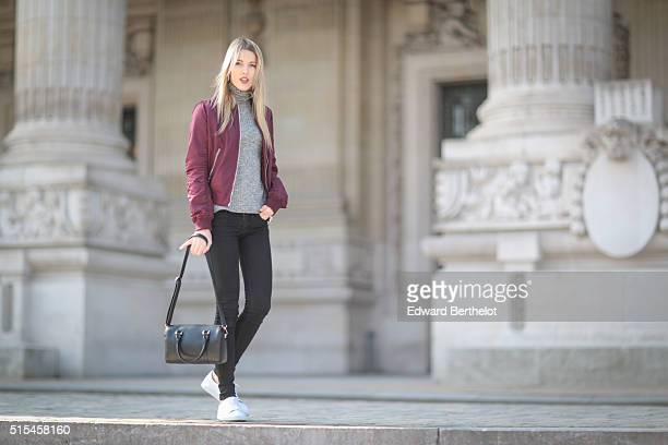 Fashion Blogger Meryl Denis is wearing Abercrombie black jeans a Boohoo top a Top Shop purple jacket Agnes B shoes and an Agnes B bag during a street...