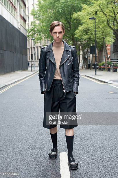 Fashion blogger Mikko Puttonen wears a H and M Trend jacket Alexander Mcqueen shoes Acne skirt Cos shirt and Onar studios bag on day 3 of London...