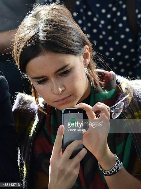 Fashion blogger Mira Duma watches the runway show at Delpozo MercedesBenz Fashion Week Fall 2014 at Skylight Ltd on February 9 2014 in New York City