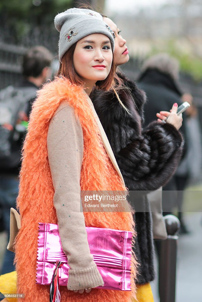 Fashion blogger Miu wearing a MSGM coat and a Martin Margiela bag after the Songzio show during Paris Fashion Week Menswear Fall Winter 2016/2017 on January 23, 2016 in Paris, France.