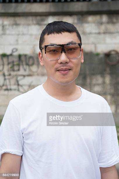 Fashion Blogger Moki Cho wears a Faith Connexion shirt and a Loewe sunglasses on day 1 of Paris Collections Men on June 22 2016 in Paris France Moki...