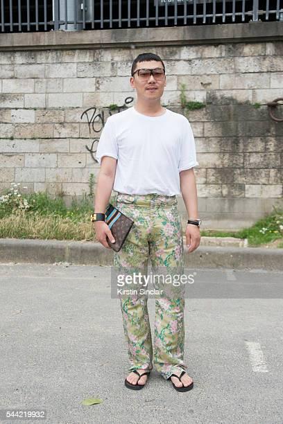 Fashion Blogger Moki Cho wears a Faith Connexion shirt Marques Almeida trousers Hermes sandals Loewe sunglasses and bracelet and a Louis Vuitton...