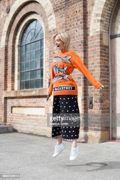 Fashion Blogger Nadia Fairfax is wearing an Alaia skirt Stella McCartney sweater vintage belt and SuperGa shoes during MercedesBenz Fashion Week...