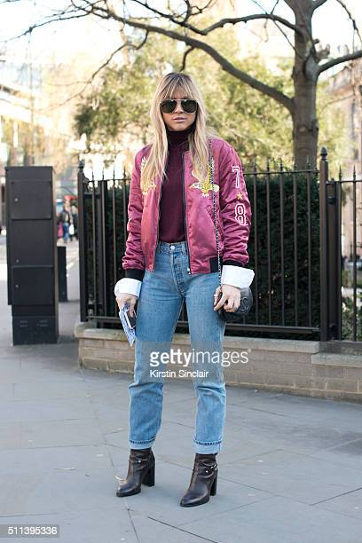 Fashion blogger Natalia Georgala wears a Diesel bomber jacket Levi's jeans Zara boots Chanel bag and Boyy sunglasses on day 1 during London Fashion...