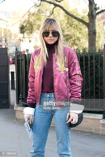 Fashion blogger Natalia Georgala wears a Diesel bomber jacket Levi's jeans Chanel bag and Boyy sunglasses on day 1 during London Fashion Week...