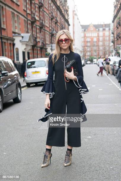 Fashion blogger Natalia Georgala wears a Zara jumpsuit Storets top Malone Souliers shoes Coach bag and Gucci sunglasses on day 4 of London Womens...