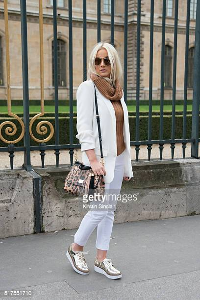 Fashion Blogger Natana Marques de Leon wears a Zara jacket and trousers Aldo shoes Dior sunglasses and Dolce Gabanna bag on day 4 during Paris...