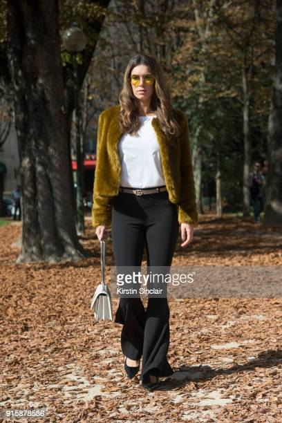 Fashion blogger Nathalie Vanden Berg wears Dior shoes Saint Laurent bag Gucci belt Zara top Bershka pants and RayBan sunglasses day 4 of Paris Womens...