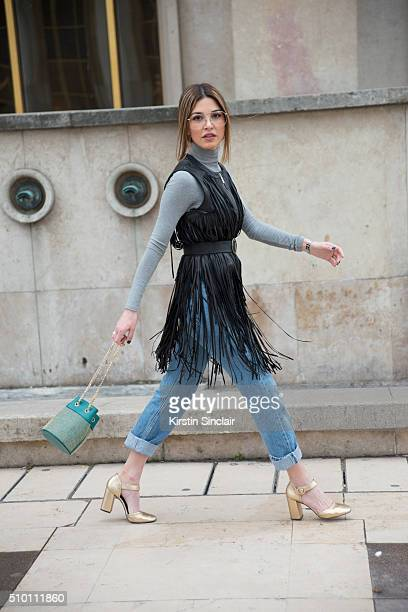 Fashion blogger Negin Mirsalehi wears an Elie Saab gilet and bag Topshop top and shoes levi'u2019s jeans and vintage glasses on day 4 of Paris Haute...