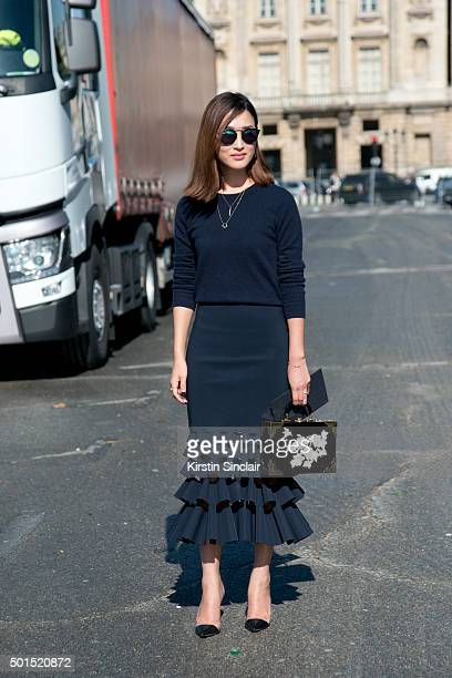 Fashion Blogger Nicole Warne wears a Dion Lee skirt Charlotte Olympia bag Uniqlo jumper Dior sunglasses and a Gianvito Rossi shoes on day 8 during...