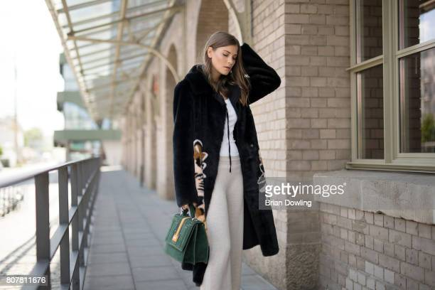 Fashion Blogger Nina Schwichtenberg poses at the Marc Cain street style shooting during MercedesBenz Fashion Week Berlin Spring/Summer 2018 on July 4...