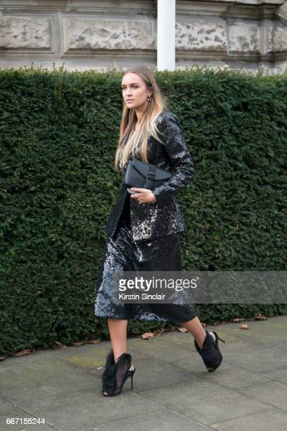 Fashion blogger Nina Suess wears all Christopher Kane with Aperlai shoes on day 4 of London Womens Fashion Week Autumn/Winter 2017 on February 20...
