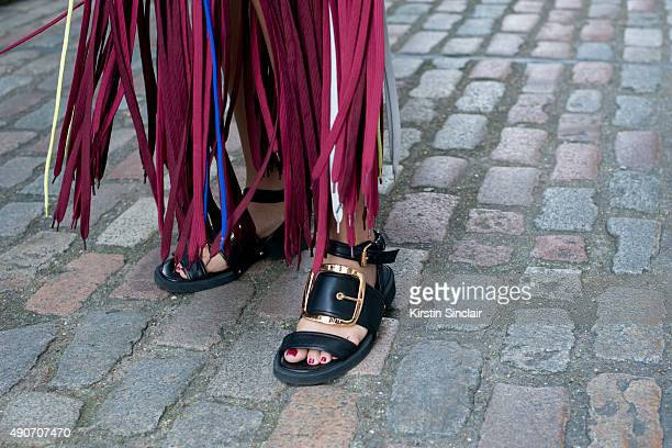 Fashion Blogger Nina Swess wears a Lee Ma Mr dress and Givenchy shoes on day 3 during London Fashion Week Spring/Summer 2016/17 on September 20 2015...