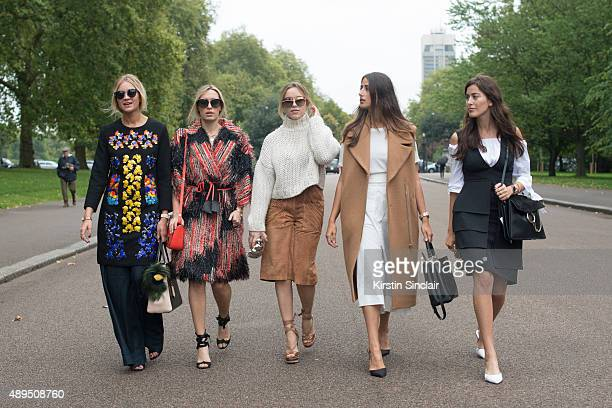 Fashion blogger Nina Swess wears Peter Pilotto dress J Brand jeans Gentle Monster sunglasses and Fendi bag With fashion blogger Camila Carril wears...