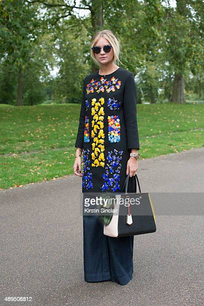 Fashion blogger Nina Swess wears Peter Pilotto dress J Brand jeans Gentle Monster sunglasses and Fendi bag on day 4 during London Fashion Week...