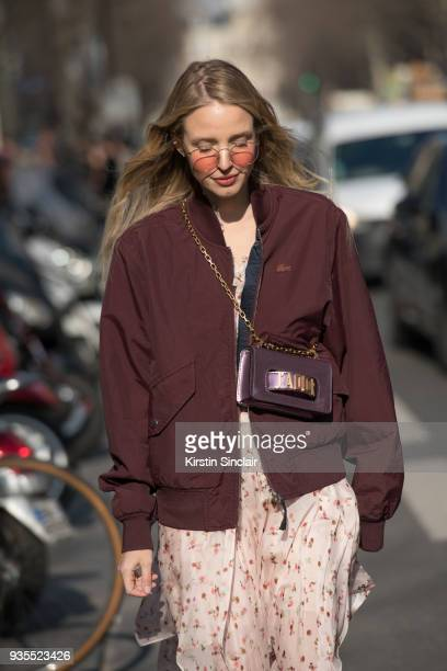 Fashion blogger of ohhcouture Leonie Hanne wears a Dior bag Philosophy dress Lacoste jacket and illesteva sunglasses day 3 of Paris Womens Fashion...