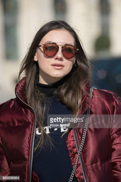 Fashion Blogger of Stiletto Shades Andreea Cristea wears an Ivy Park puffer jacket Dior sunglasses Chinti and Parker jumper day 3 of Paris Womens...