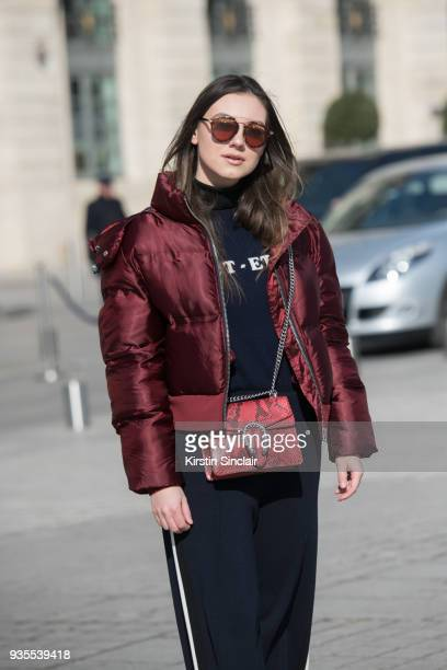 Fashion Blogger of Stiletto Shades Andreea Cristea wears an Ivy Park puffer jacket Dior sunglasses Chinti and Parker jumper and trousers Gucci bag...