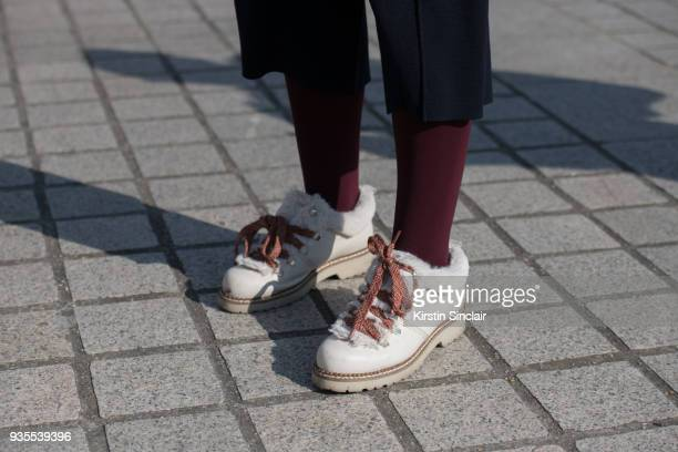 Fashion Blogger of Stiletto Shades Andreea Cristea wears Russell and Bromley shoes day 3 of Paris Womens Fashion Week Spring/Summer 2018 on February...