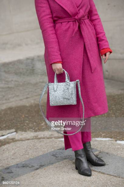 Fashion blogger of stilettoshades Andreea Cristea wears a Boden coat Helmer bag Zara boots Pinko trousers day 4 of Paris Womens Fashion Week...