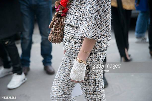 Fashion Blogger of The Blonde Salad Chiara Ferragni wears a suit gloves clutch by Chanel on day 3 of Paris Haute Couture Fashion Week Spring/Summer...