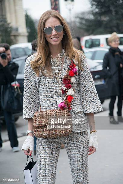 Fashion Blogger of The Blonde Salad Chiara Ferragni wears a suit gloves clutch by Chanel and Dior sunglasses on day 3 of Paris Haute Couture Fashion...