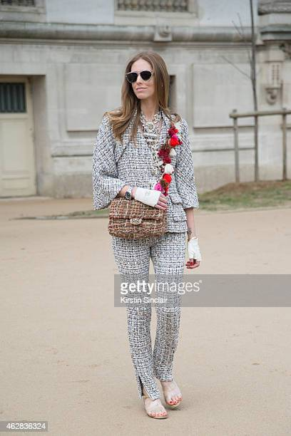 Fashion Blogger of The Blonde Salad Chiara Ferragni wears a suit shoes gloves clutch by Chanel and Dior sunglasses on day 3 of Paris Haute Couture...