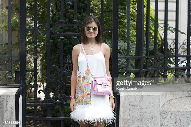 Fashion blogger of The Russian Code Elvira Abasova wears own design dress Roger Vivier bag and Ray Ban sunglasses on day 1 of Paris Fashion Week...