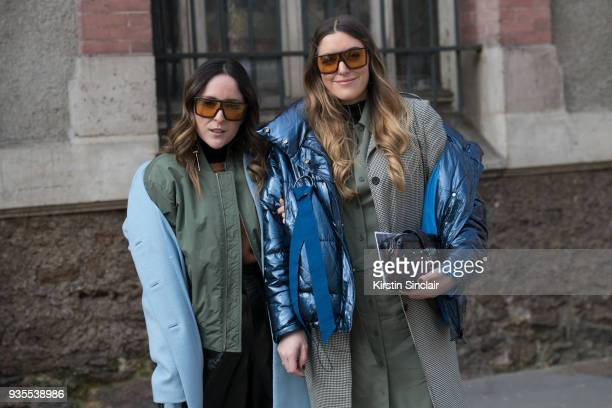 Fashion blogger of thedoubledenim Ari Camacho wears a Lacoste knit jumper and jacket HM coat And other stories trousers and Tommy Hilfiger sunglasses...