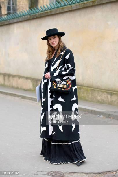 Fashion blogger of zinafashionvibe Zina Charkoplia wears all Dior day 2 of Paris Womens Fashion Week Spring/Summer 2018 on February 27 2018 in London...