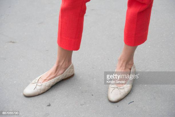 Fashion blogger Oksana Erdogdu wears a Chanel suit and shoes on day 3 of Paris Haute Couture Fashion Week Autumn/Winter 2016, on July 5, 2016 in...