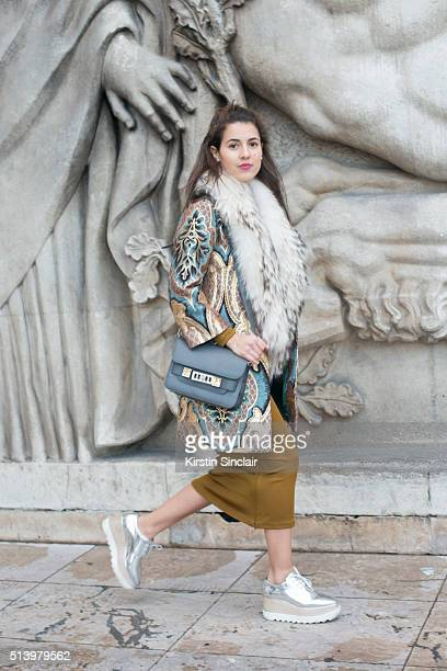 Fashion blogger Pamela Allier wears a H and M dress Proenza Schouler bag and a vintage coat on day 2 during Paris Fashion Week Autumn/Winter 2016/17...