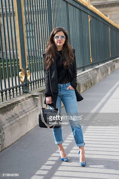 Fashion Blogger Pamela Allier wears a Louis Vuitton top Lorena Saravia jacket Manolo Blahnik shoes Chanel glasses Leviâs trousers and Dolce and...