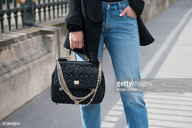 Fashion Blogger Pamela Allier wears Leviâs trousers and Dolce and Gabanna bag on day 4 during Paris Fashion Week Autumn/Winter 2016/17 on March 4...