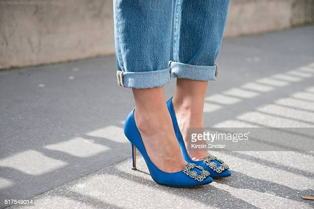 Fashion Blogger Pamela Allier wears Manolo Blahnik shoes and Levis jeans on day 4 during Paris Fashion Week Autumn/Winter 2016/17 on March 4 2016 in...