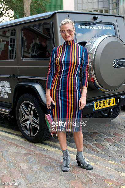 Fashion Blogger Pandora Sykes wears a House of Hackney dress and Ray Ban sunglasses on day 3 during London Fashion Week Spring/Summer 2016/17 on...