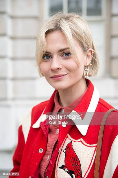 Fashion Blogger Pandora Sykes wears a vintage Varsity jacket Gucci bag AG Alex Chung dress on day 1 of London Collections Women on February 20 2015...